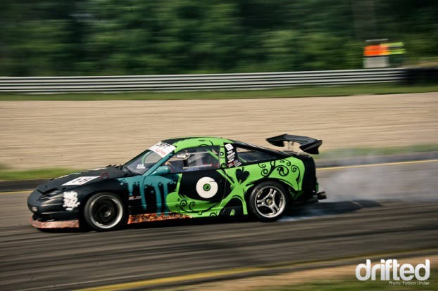 Sebastien Namur, graffiti artist, painted Cerdan Nicolas S13 with a big, green skull
