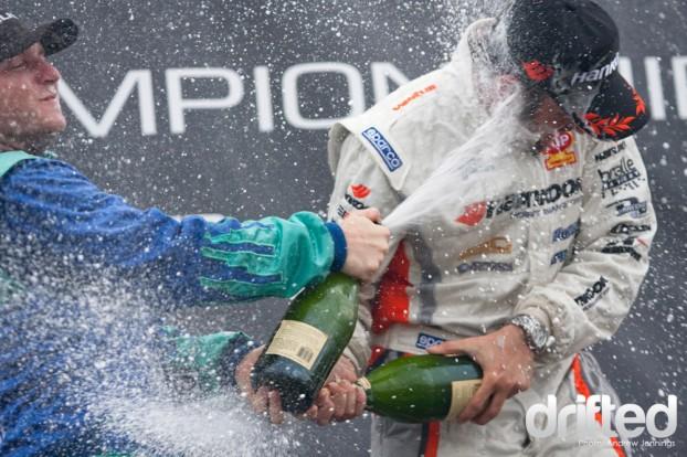 Conrad Grunewald and Justin Pawlak Podium Champagne