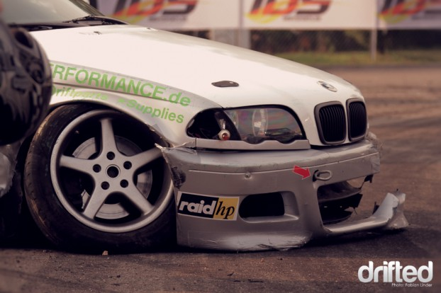 """BMW E46 now that is what they call """"Hellaflush"""". The car sits so low the bumper has smashed itself apart."""