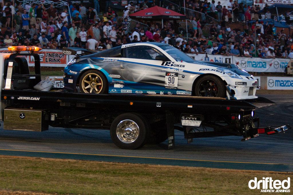 Pat Mordaunt's Nissan 350Z is towed at Formula Drift Road Atlanta