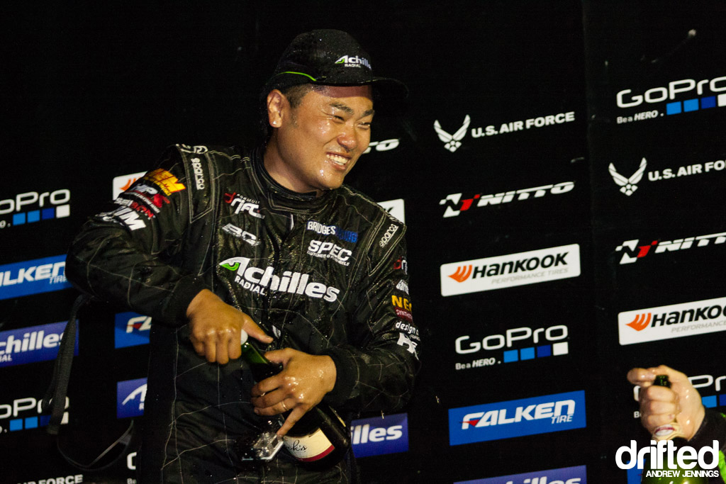 Daigo Saito smiling with champagne