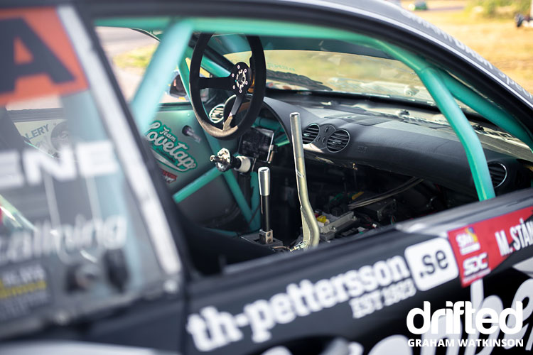drift car interior with racing steering wheel
