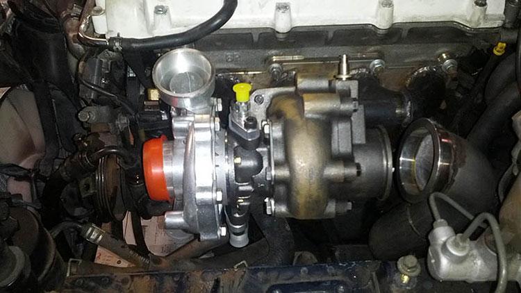 mkturbo miata turbo kit installed in engine bay