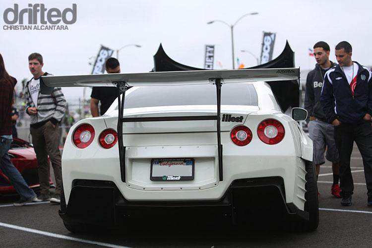 white r35 gtr parked with vr38dett
