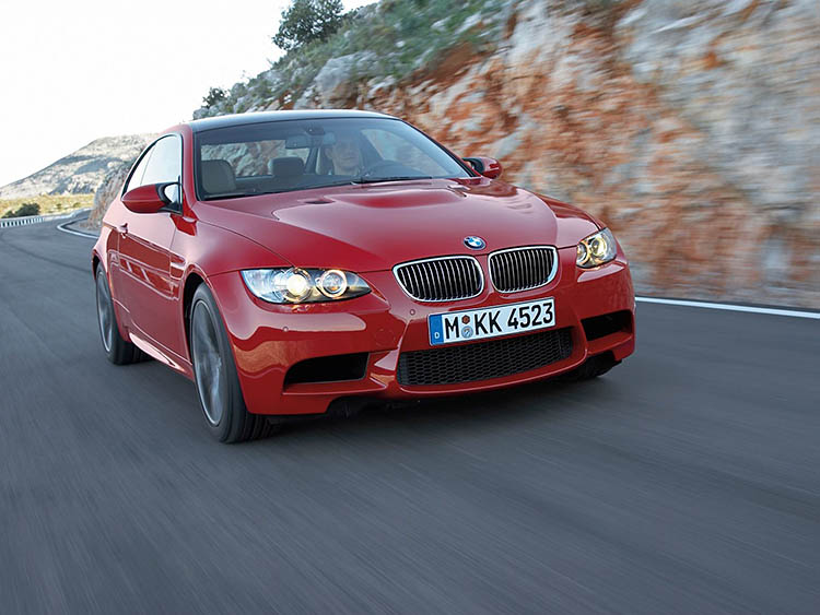 red bmw m3 rolling tracking shot