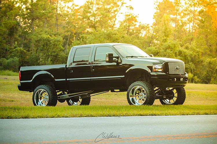 ford black pickup f250 raised 24 inch 6.0 powerstroke