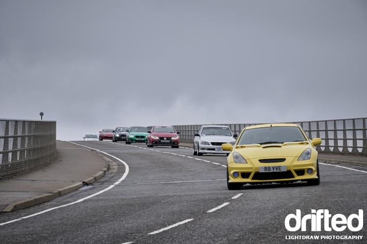 toyota celica leads car convoy