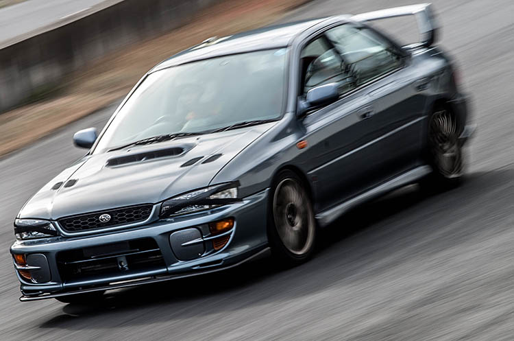 grey race car pan speed impreza